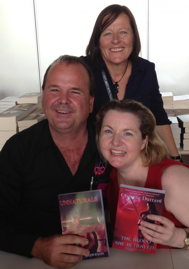 Debut urban fantasy authors Dean J Anderson and Cheryse Durrant with New York Times bestselling author Keri Arthur at the launch of their novels at GenreCon at the State Library of Queensland on Saturday, October 12, 2013.